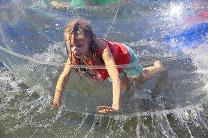 Zorbing. Girl inside a zorb