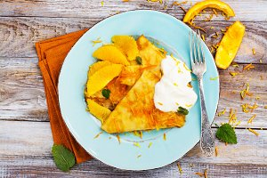 Traditional french dessert crepes suzette with orange syrup