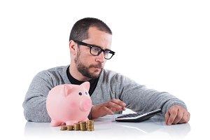 worried man with piggy bank
