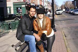 Couple  in a bench with  coffee