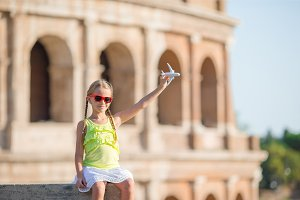 Adorable little girl in front of Colosseum in Rome, Italy. Kid on italian vacation