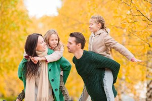 Beautiful happy family in autumn day outdoors
