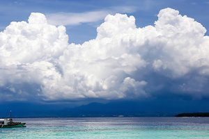 Tropical ship sailing with beautiful cloudscape and seascape
