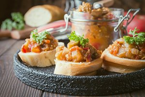 Bread toasts with eggplant caviar.