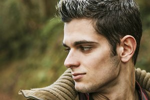 portrait of young man in profile outdoors