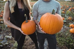 Couple holding pumpkin