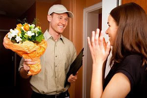 Delivery Boy Handing Over Flowers