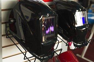 Helmets for black welder exposed for sale.