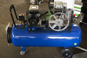 Blue compressor exposed for sale.