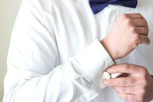 Man fastening a cuff