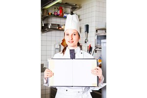 Female Chef Holding Blank Menu