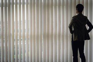 Businesswoman standing near the window