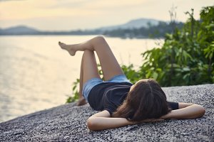 woman relax on rocky cliff