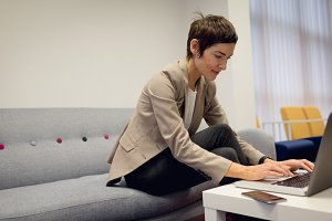 Businesswoman working over laptop in office