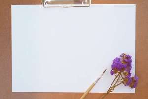 Clipboard with plank paper and brush
