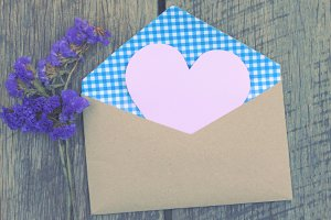 Blank paper heart shape in envelope