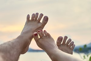 Couple's feet having fun