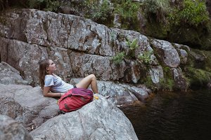 Young woman relaxing on a rock