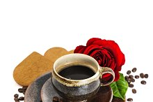 Cup of black coffee and red rose flo