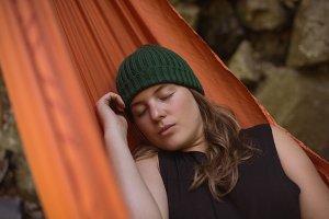 Woman sleeping in hammock