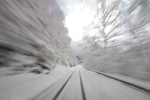 Speed on snowy road at winter