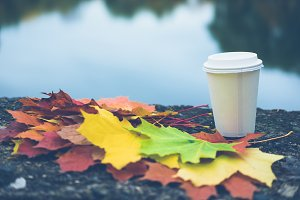 Coffee with fallen autumn leaves
