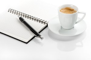 black coffee and open note book