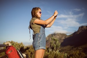 Young woman taking picture from mobile phone