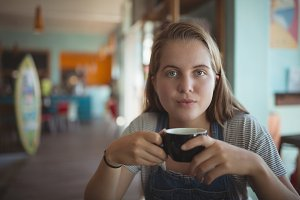 Portrait of woman having coffee