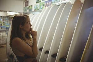 Woman selecting a surfboard