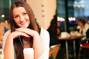 Pretty Single Lady Sitting In A Cafe