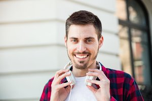 portrait of young cheerful attractive man outdoors