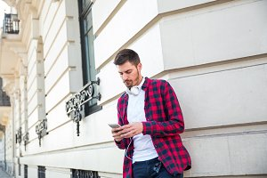 young casual attractive man using phone