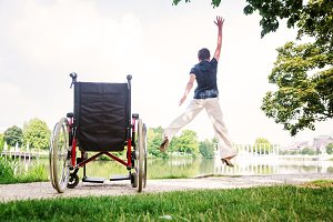 Senior Woman Jumping Up From Wheelchair