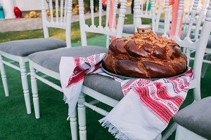 Traditional Ukrainian wedding bread loaf in wedding ceremony area