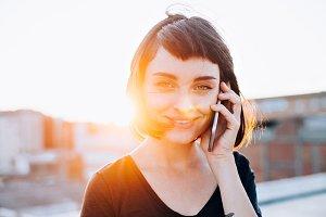 Pretty brunette talks on phone