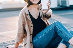 Cute pretty woman drinks coffee