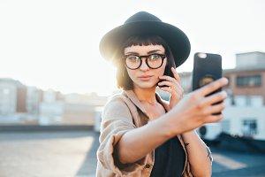 Cute influencer makes selfie
