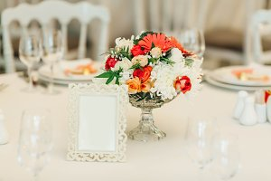 Table decor with flowers table numbers. Wedding banquet decoration. Copy space