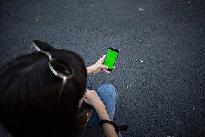 Woman holds phone mockup