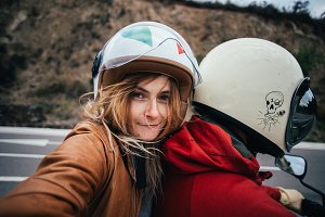 Selfie of motorcycle passenger