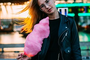 Model with cotton candy at carnival