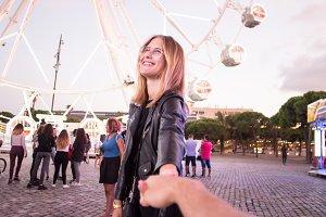 Couple on festival fair ferris wheel