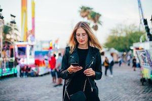 Young woman chats and texts on phone