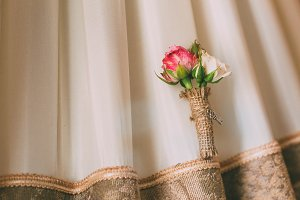Boutonniere on a lace background