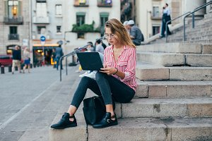 Student works outdoors with laptop