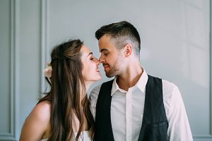 Young and happy newlyweds are touching noses