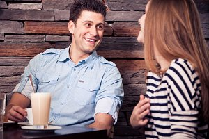 Young Couple Sitting In A Cafe