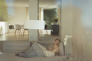 Couple resting on sofa in living room