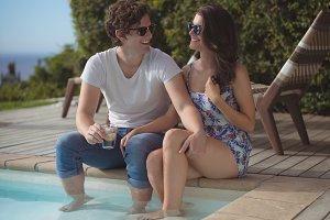 Smiling couple enjoying near pool side
